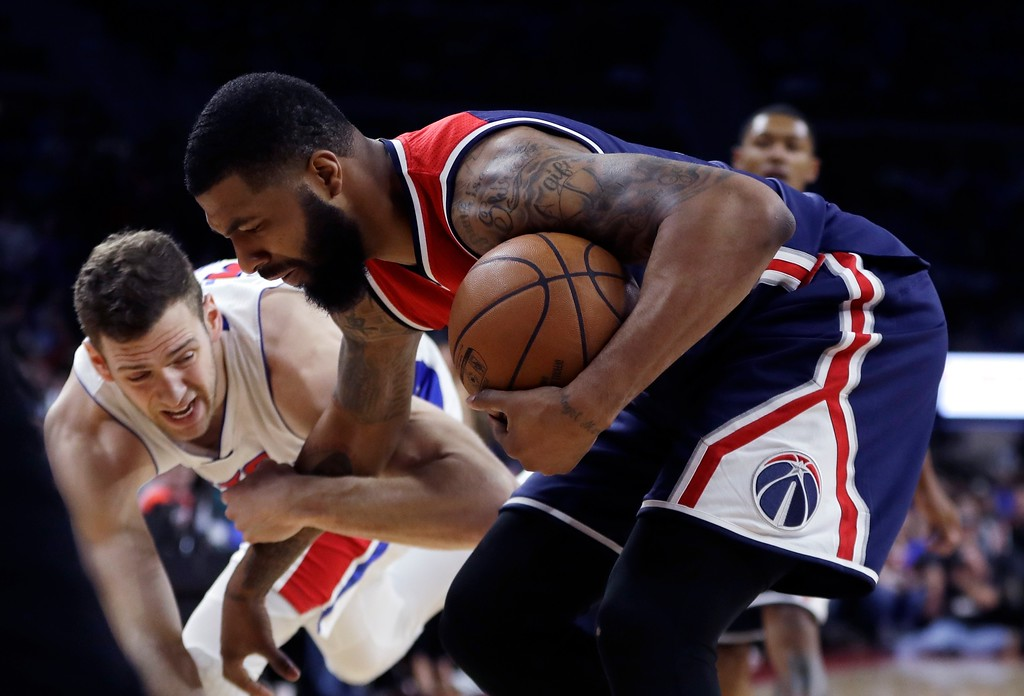 . Detroit Pistons forward Jon Leuer (30) fouls Washington Wizards forward Markieff Morris during second half of an NBA basketball game, Monday, April 10, 2017, in Auburn Hills, Mich. (AP Photo/Carlos Osorio)