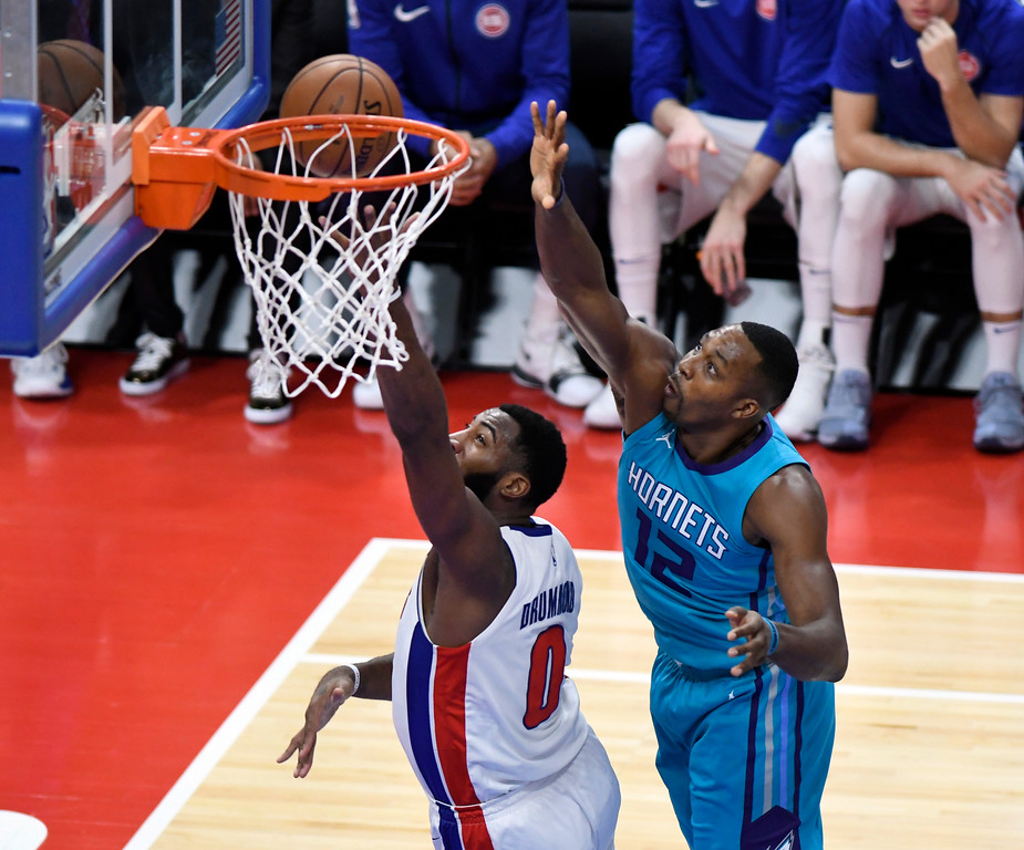 . Detroit Pistons center Andre Drummond (0) puts in a layup past Charlotte Hornets center Dwight Howard (12) in the first quarter, Wednesday, Oct. 18, 2017 in Detroit.  (Special to The Oakland Press/Jose Juarez)