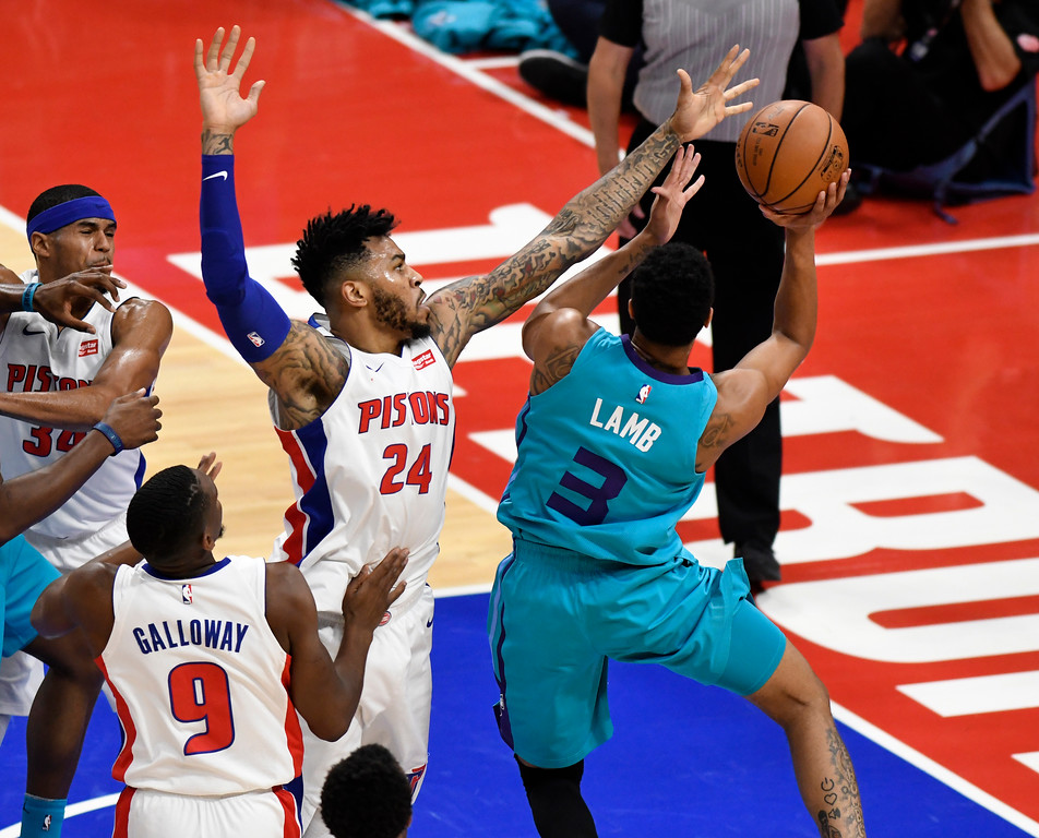 . Detroit Pistons forward Tobias Harris (34) dunks past Charlotte Hornets center Dwight Howard (12) in the first quarter, Wednesday, Oct. 18, 2017 in Detroit.  (Special to The Oakland Press/Jose Juarez)