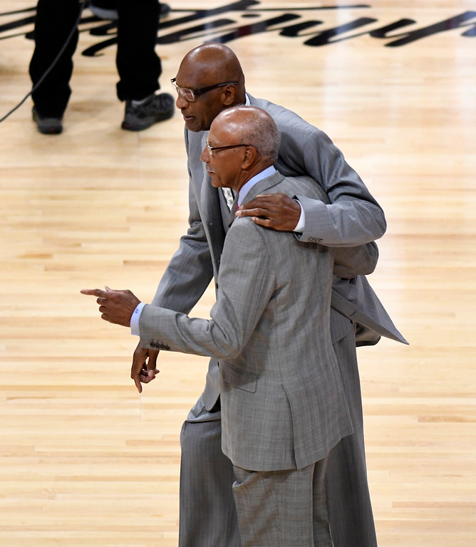 . Former Detroit Pistons players Dave Bing, front, and Bob Lanier pose for photos at Little Caesars Arena before a game with the Charlotte Hornets, Wednesday, Oct. 18, 2017 in Detroit.  (Special to The Oakland Press/Jose Juarez)