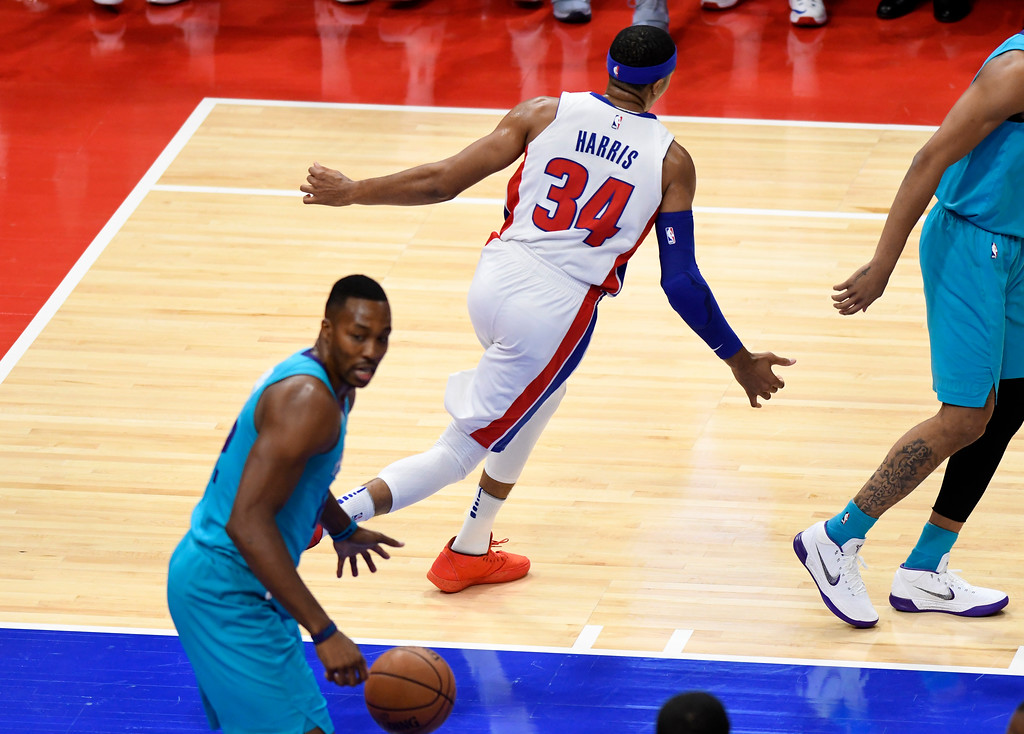 . Detroit Pistons forward Tobias Harris (34), celebrates his dunk over Charlotte Hornets center Dwight Howard (12) in the first quarter, Wednesday, Oct. 18, 2017 in Detroit.  (Special to The Oakland Press/Jose Juarez)