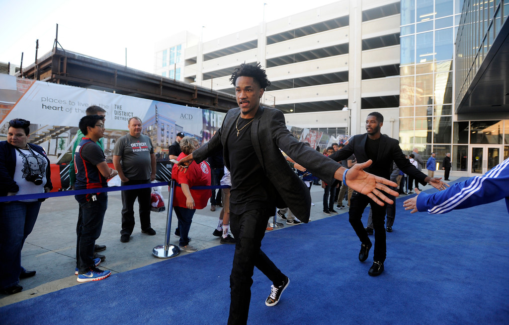 . Detroit Pistons guard Luis Montero walks the blue carpet past fans as he heads into Little Caesars Arena before a game with the Charlotte Hornets, Wednesday, Oct. 18, 2017 in Detroit.  (Special to The Oakland Press/Jose Juarez)