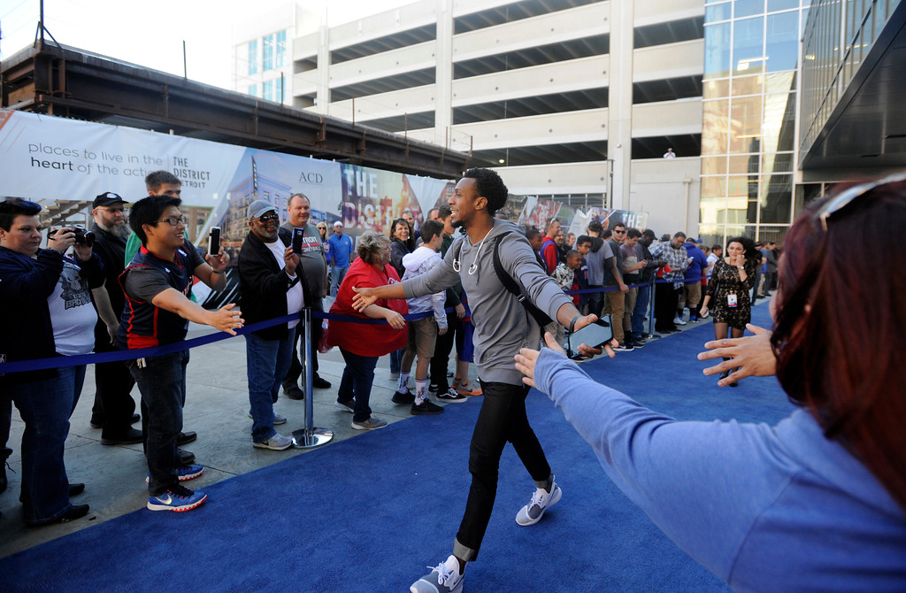 . Detroit Pistons guard Ish Smith walks the blue carpet past fans as he heads into Little Caesars Arena before a game with the Charlotte Hornets, Wednesday, Oct. 18, 2017 in Detroit.  (Special to The Oakland Press/Jose Juarez)
