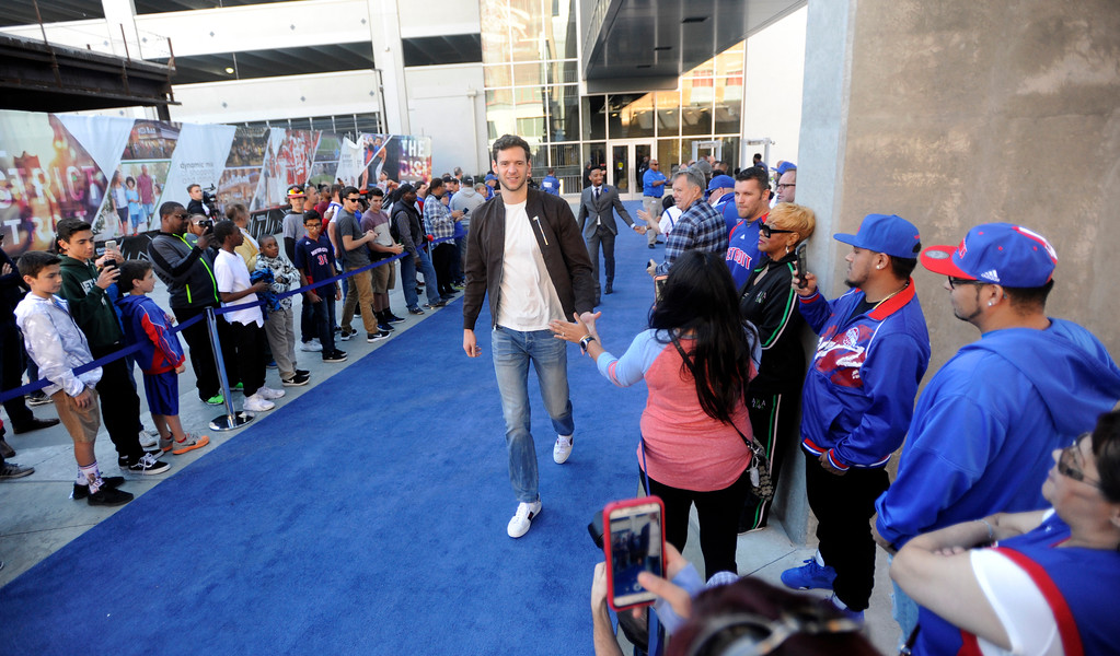 . Detroit Pistons forward Jon Leuer walks the blue carpet past fans as he heads into Little Caesars Arena before a game with the Charlotte Hornets, Wednesday, Oct. 18, 2017 in Detroit.  (Special to The Oakland Press/Jose Juarez)