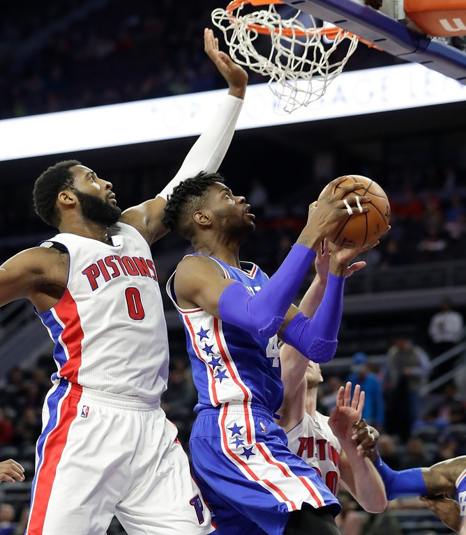 . Detroit Pistons center Andre Drummond (0) defends as Philadelphia 76ers forward Nerlens Noel (4) shoots during the second half of an NBA basketball game, Monday, Feb. 6, 2017, in Auburn Hills, Mich. (AP Photo/Carlos Osorio)
