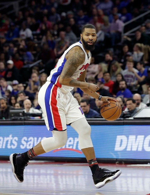 . Detroit Pistons forward Marcus Morris controls the ball during the first half of an NBA basketball game against the Philadelphia 76ers, Monday, Feb. 6, 2017, in Auburn Hills, Mich. (AP Photo/Carlos Osorio)