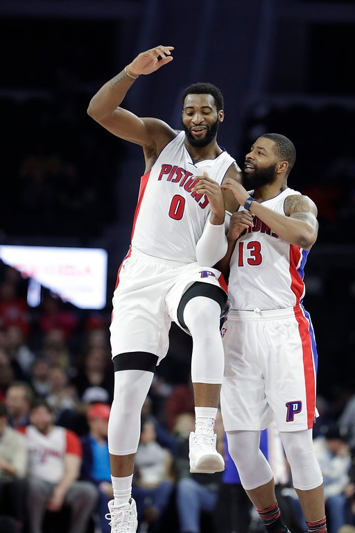 . Detroit Pistons center Andre Drummond, left, is congratulated by teammate forward Marcus Morris (13) after a dunk during the second half of an NBA basketball game against the Philadelphia 76ers, Monday, Feb. 6, 2017, in Auburn Hills, Mich. (AP Photo/Carlos Osorio)