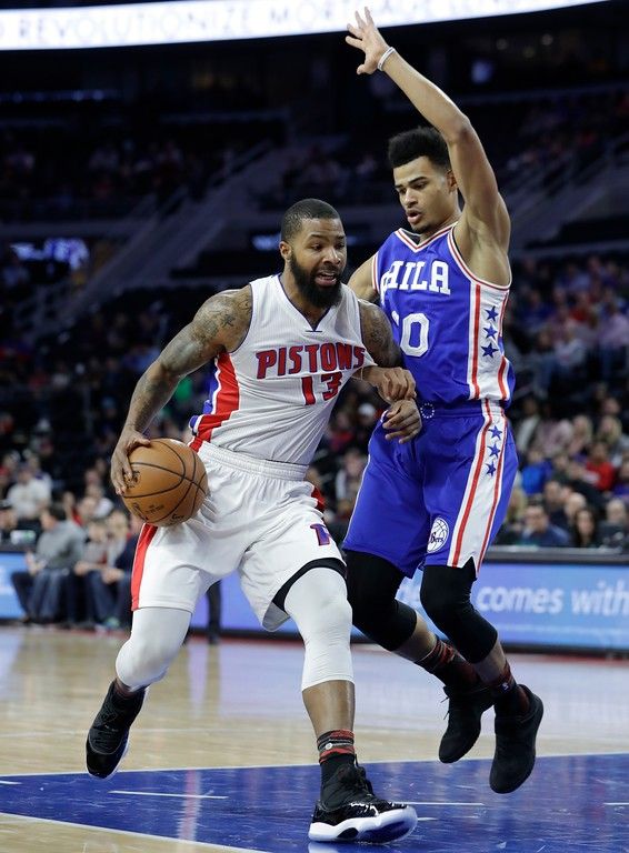 . Philadelphia 76ers guard Timothe Luwawu-Cabarrot fouls Detroit Pistons forward Marcus Morris (13) during the first half of an NBA basketball game, Monday, Feb. 6, 2017, in Auburn Hills, Mich. (AP Photo/Carlos Osorio)