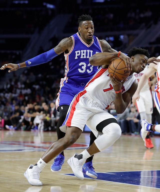 . Detroit Pistons forward Stanley Johnson (7) drives around Philadelphia 76ers forward Robert Covington (33) during the first half of an NBA basketball game, Monday, Feb. 6, 2017, in Auburn Hills, Mich. (AP Photo/Carlos Osorio)