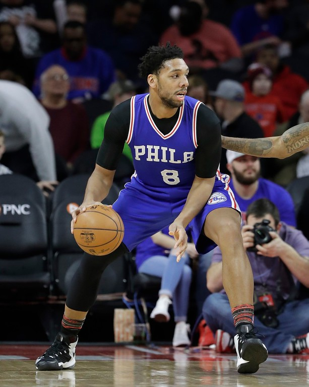 . Philadelphia 76ers center Jahlil Okafor controls the ball during the first half of an NBA basketball game against the Detroit Pistons, Monday, Feb. 6, 2017, in Auburn Hills, Mich. (AP Photo/Carlos Osorio)