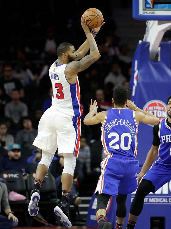 . Detroit Pistons forward Marcus Morris (13) passes the ball as Philadelphia 76ers guard Timothe Luwawu-Cabarrot (20) approaches during the second half of an NBA basketball game, Monday, Feb. 6, 2017, in Auburn Hills, Mich. (AP Photo/Carlos Osorio)