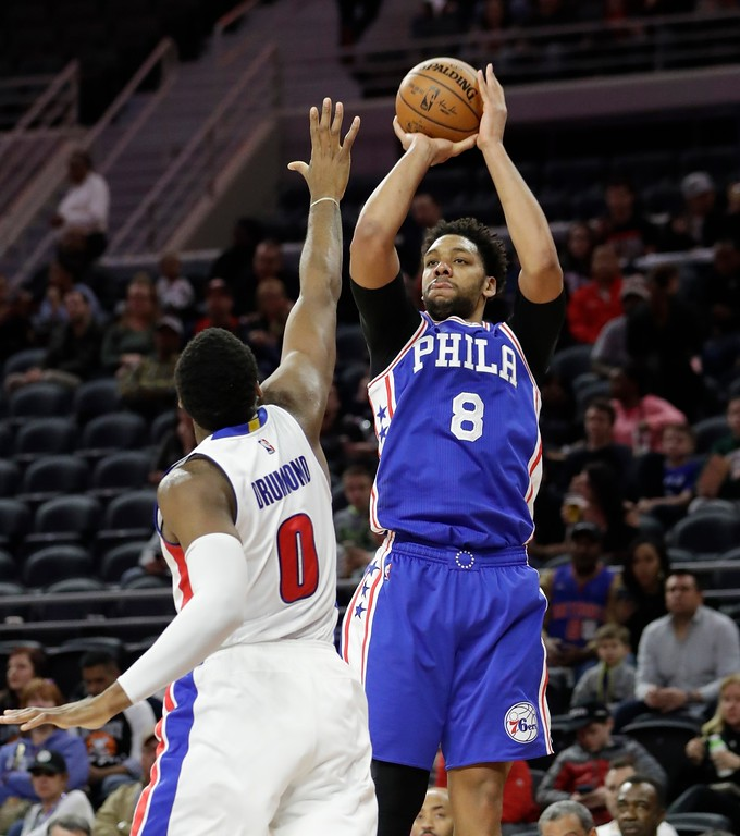 . Philadelphia 76ers center Jahlil Okafor (8) shoots over Detroit Pistons center Andre Drummond (0) during the second half of an NBA basketball game, Monday, Feb. 6, 2017, in Auburn Hills, Mich. (AP Photo/Carlos Osorio)