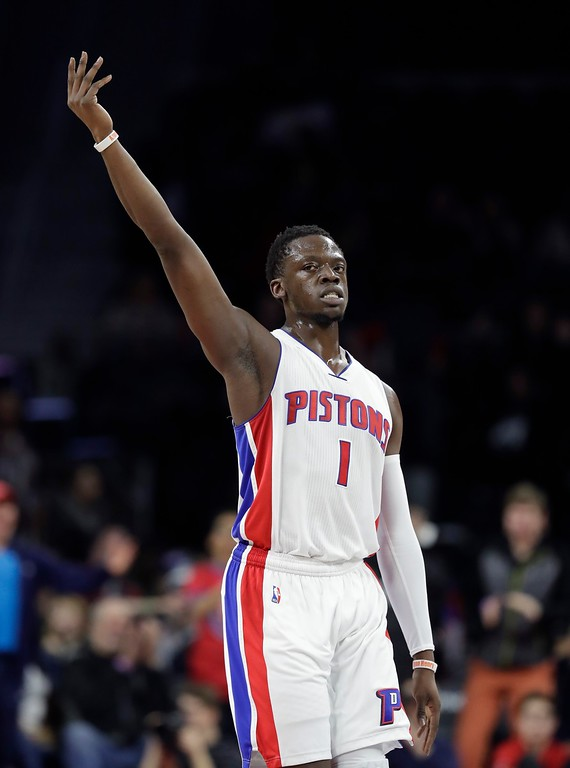 . Detroit Pistons guard Reggie Jackson acknowledges the crowd after a three-point basket during the second half of an NBA basketball game against the Philadelphia 76ers, Monday, Feb. 6, 2017, in Auburn Hills, Mich. (AP Photo/Carlos Osorio)
