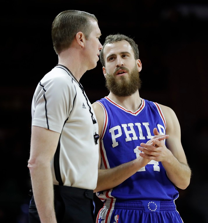 . Philadelphia 76ers guard Sergio Rodriguez (14) talks with referee Ed Malloy during the first half of an NBA basketball game against the Detroit Pistons, Monday, Feb. 6, 2017, in Auburn Hills, Mich. (AP Photo/Carlos Osorio)