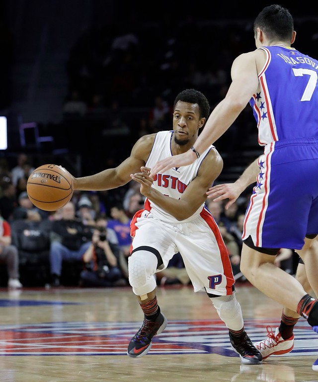 . Detroit Pistons guard Ish Smith dribbles around Philadelphia 76ers forward Ersan Ilyasova (7) during the first half of an NBA basketball game, Monday, Feb. 6, 2017, in Auburn Hills, Mich. (AP Photo/Carlos Osorio)