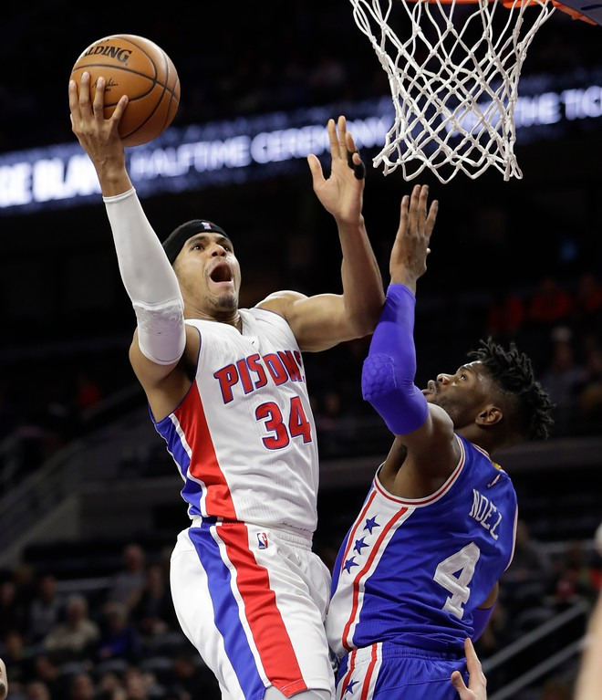 . Detroit Pistons forward Tobias Harris (34) makes a layup on Philadelphia 76ers forward Nerlens Noel (4) during the first half of an NBA basketball game, Monday, Feb. 6, 2017, in Auburn Hills, Mich. (AP Photo/Carlos Osorio)