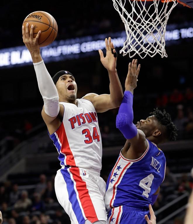 . Detroit Pistons forward Tobias Harris (34) makes a layup on Philadelphia 76ers forward Nerlens Noel (4) during the first half of an NBA basketball game, Monday, Feb. 6, 2017, in Auburn Hills, Mich. (AP Photo/Carlos Osorio)