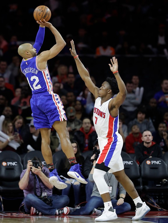 . Philadelphia 76ers guard Gerald Henderson (12) shoots over Detroit Pistons forward Stanley Johnson (7) during the first half of an NBA basketball game, Monday, Feb. 6, 2017, in Auburn Hills, Mich. (AP Photo/Carlos Osorio)