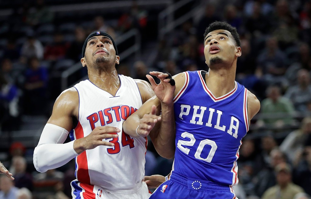 . Detroit Pistons forward Tobias Harris (34) and Philadelphia 76ers guard Timothe Luwawu-Cabarrot (20) watch a free throw during the second half of an NBA basketball game, Monday, Feb. 6, 2017, in Auburn Hills, Mich. (AP Photo/Carlos Osorio)