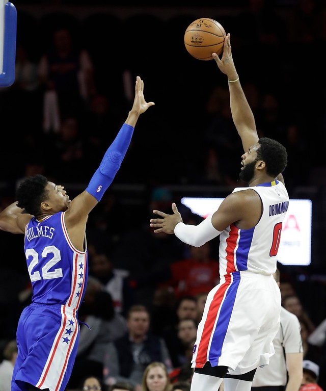 . Detroit Pistons center Andre Drummond (0) shoots over Philadelphia 76ers forward Richaun Holmes (22) during the second half of an NBA basketball game, Monday, Feb. 6, 2017, in Auburn Hills, Mich. (AP Photo/Carlos Osorio)