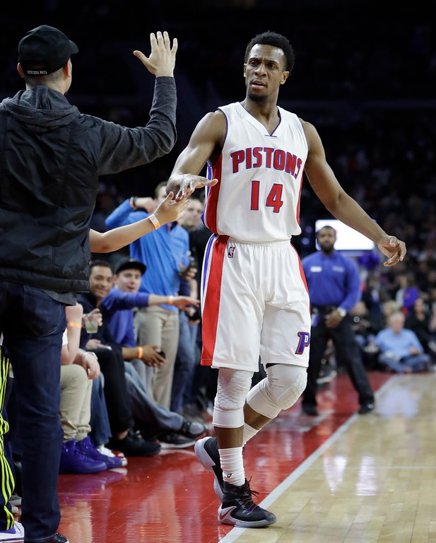 . Detroit Pistons guard Ish Smith high fives fans after a three-point basket during the first half of an NBA basketball game against the Cleveland Cavaliers, Thursday, March 9, 2017, in Auburn Hills, Mich. (AP Photo/Carlos Osorio)