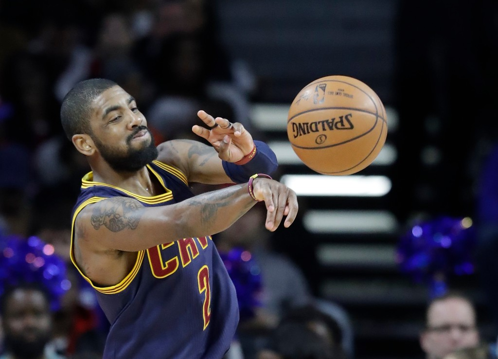 . Cleveland Cavaliers guard Kyrie Irving passes the ball during the first half of an NBA basketball game against the Cleveland Cavaliers, Thursday, March 9, 2017, in Auburn Hills, Mich. (AP Photo/Carlos Osorio)