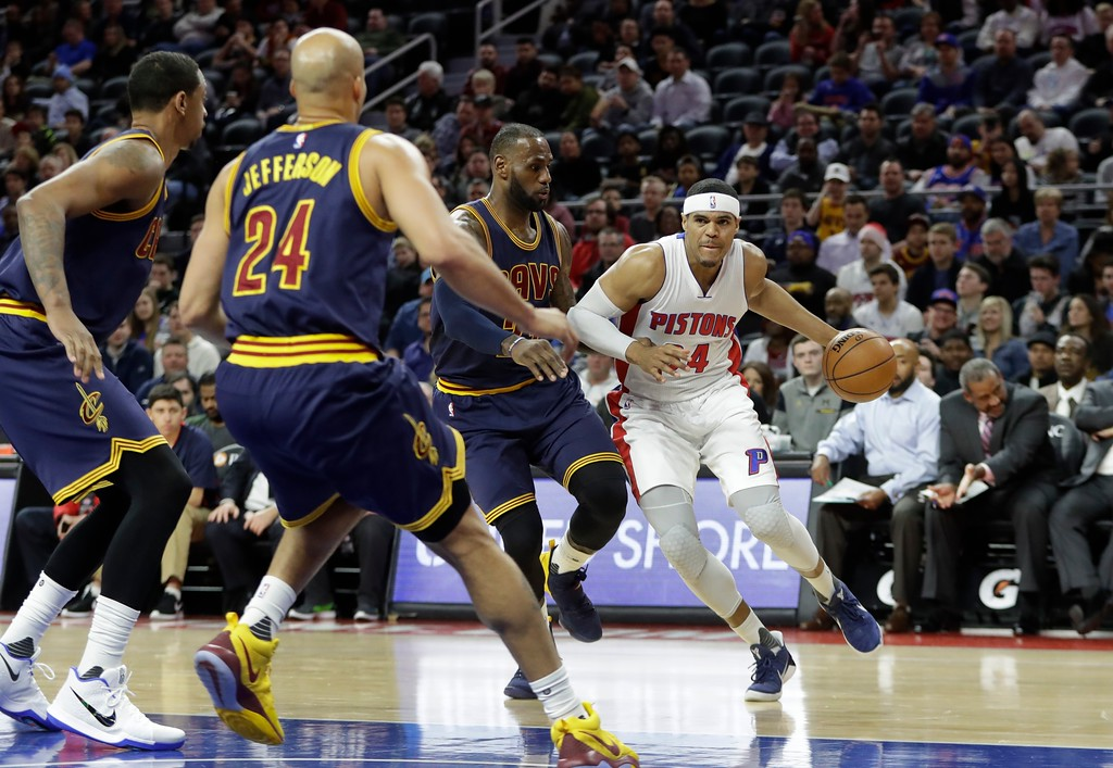 . Detroit Pistons forward Tobias Harris (34) drives around Cleveland Cavaliers forward LeBron James (23) during the first half of an NBA basketball game, Thursday, March 9, 2017, in Auburn Hills, Mich. (AP Photo/Carlos Osorio)