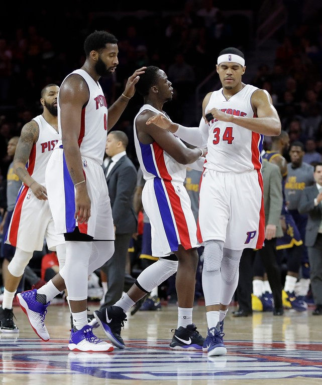 . Detroit Pistons center Andre Drummond, left, an dDetroit Pistons forward Tobias Harris, right, congratulated guard Reggie Jackson after a basket during the second half of an NBA basketball game against the Cleveland Cavaliers, Thursday, March 9, 2017, in Auburn Hills, Mich. (AP Photo/Carlos Osorio)