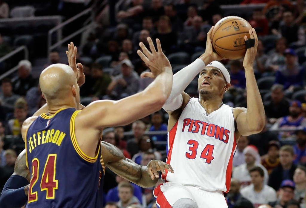 . Detroit Pistons forward Tobias Harris (34) shoots defended by Cleveland Cavaliers forward Richard Jefferson (24) during the first half of an NBA basketball game, Thursday, March 9, 2017, in Auburn Hills, Mich. (AP Photo/Carlos Osorio)