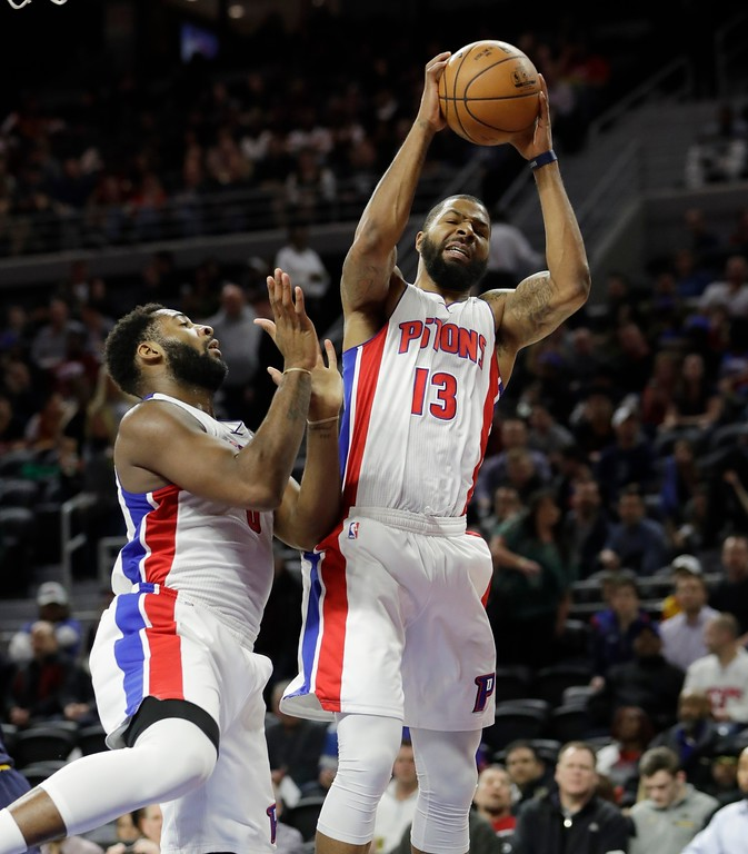 . Detroit Pistons forward Marcus Morris (13) recovers a rebound next to center Andre Drummond during the second half of an NBA basketball game against the Cleveland Cavaliers, Thursday, March 9, 2017, in Auburn Hills, Mich. (AP Photo/Carlos Osorio)