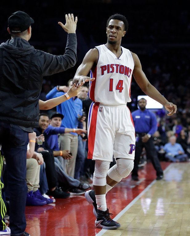 . Detroit Pistons guard Ish Smith high-fives fans after a 3-point basket during the first half of the team\'s NBA basketball game against the Cleveland Cavaliers, Thursday, March 9, 2017, in Auburn Hills, Mich. (AP Photo/Carlos Osorio)
