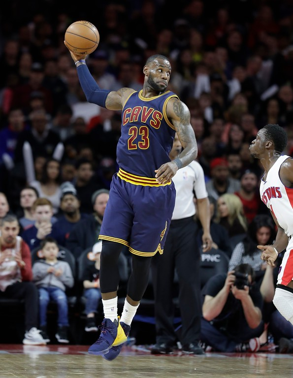 . Cleveland Cavaliers forward LeBron James passes during the first half of an NBA basketball game against the Detroit Pistons, Thursday, March 9, 2017, in Auburn Hills, Mich. (AP Photo/Carlos Osorio)
