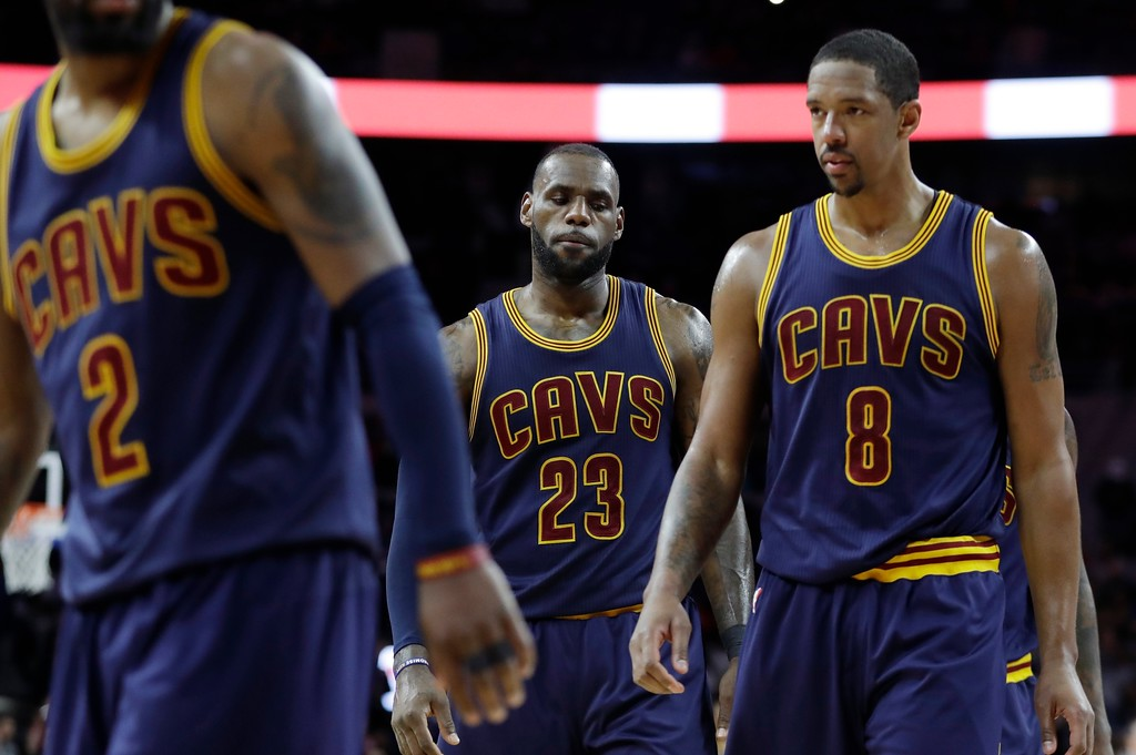 . Cleveland Cavaliers guard Kyrie Irving (2), and forwards LeBron James (23) and Channing Frye (8) walk back to the court in the closing seconds during the second half of an NBA basketball game against the Detroit Pistons, Thursday, March 9, 2017, in Auburn Hills, Mich. Detroit defeated Cleveland 106-101. (AP Photo/Carlos Osorio)