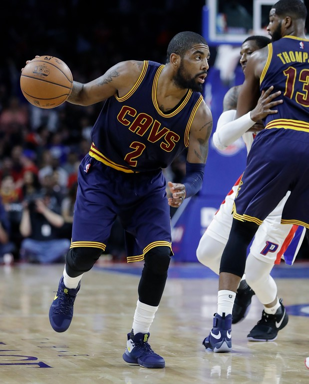 . Cleveland Cavaliers guard Kyrie Irving controls the ball during the second half of an NBA basketball game against the Detroit Pistons, Thursday, March 9, 2017, in Auburn Hills, Mich. (AP Photo/Carlos Osorio)