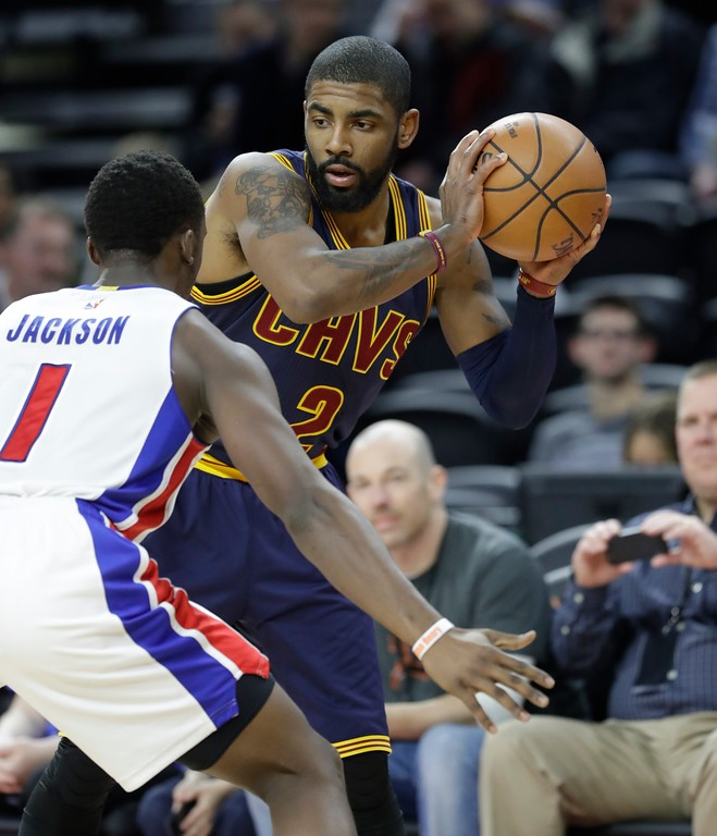 . Cleveland Cavaliers guard Kyrie Irving (2) looks to pass around Detroit Pistons guard Reggie Jackson (1) during the second half of an NBA basketball game, Thursday, March 9, 2017, in Auburn Hills, Mich. (AP Photo/Carlos Osorio)