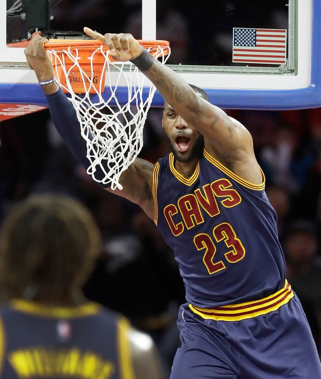 . Cleveland Cavaliers forward LeBron James points after dunking during the first half of the team\'s NBA basketball game against the Detroit Pistons, Thursday, March 9, 2017, in Auburn Hills, Mich. (AP Photo/Carlos Osorio)