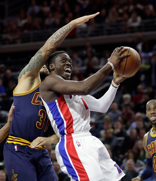 . Detroit Pistons guard Reggie Jackson goes to the basket as Cleveland Cavaliers guard Deron Williams defends during the first half of an NBA basketball game, Thursday, March 9, 2017, in Auburn Hills, Mich. (AP Photo/Carlos Osorio)