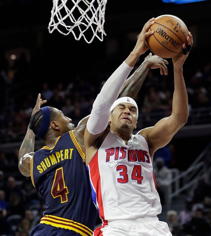 . Detroit Pistons forward Tobias Harris (34) goes to the basket against Cleveland Cavaliers guard Iman Shumpert (4) during the first half of an NBA basketball game, Thursday, March 9, 2017, in Auburn Hills, Mich. (AP Photo/Carlos Osorio)