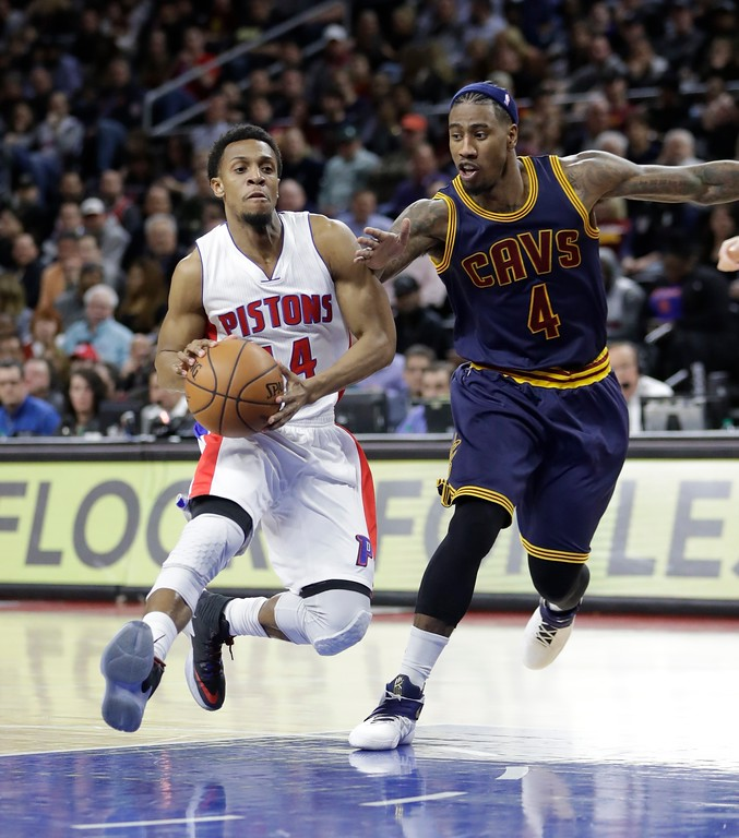 . Detroit Pistons guard Ish Smith (14) is defended by Cleveland Cavaliers guard Iman Shumpert (4) during the first half of an NBA basketball game, Thursday, March 9, 2017, in Auburn Hills, Mich. (AP Photo/Carlos Osorio)