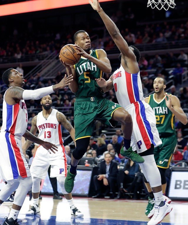 . Utah Jazz guard Rodney Hood (5) is pressured by Detroit Pistons guard Kentavious Caldwell-Pope, left, and center Andre Drummond, right, during the first half of an NBA basketball game, Wednesday, March 15, 2017, in Auburn Hills, Mich. (AP Photo/Carlos Osorio)
