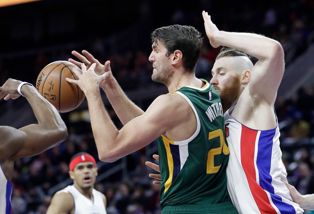 . Utah Jazz center Jeff Withey has the ball knocked out of his control as Detroit Pistons\' Aron Baynes defends during the first half of an NBA basketball game Wednesday, March 15, 2017, in Auburn Hills, Mich. (AP Photo/Carlos Osorio)