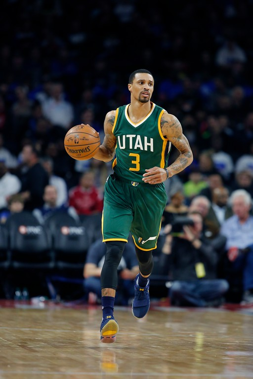 . Utah Jazz guard George Hill brings the ball up court during the first half of an NBA basketball game against the Detroit Pistons, Wednesday, March 15, 2017, in Auburn Hills, Mich. (AP Photo/Carlos Osorio)