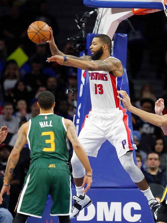. Detroit Pistons forward Marcus Morris (13) passes the ball during the first half of an NBA basketball game against the Utah Jazz, Wednesday, March 15, 2017, in Auburn Hills, Mich. (AP Photo/Carlos Osorio)