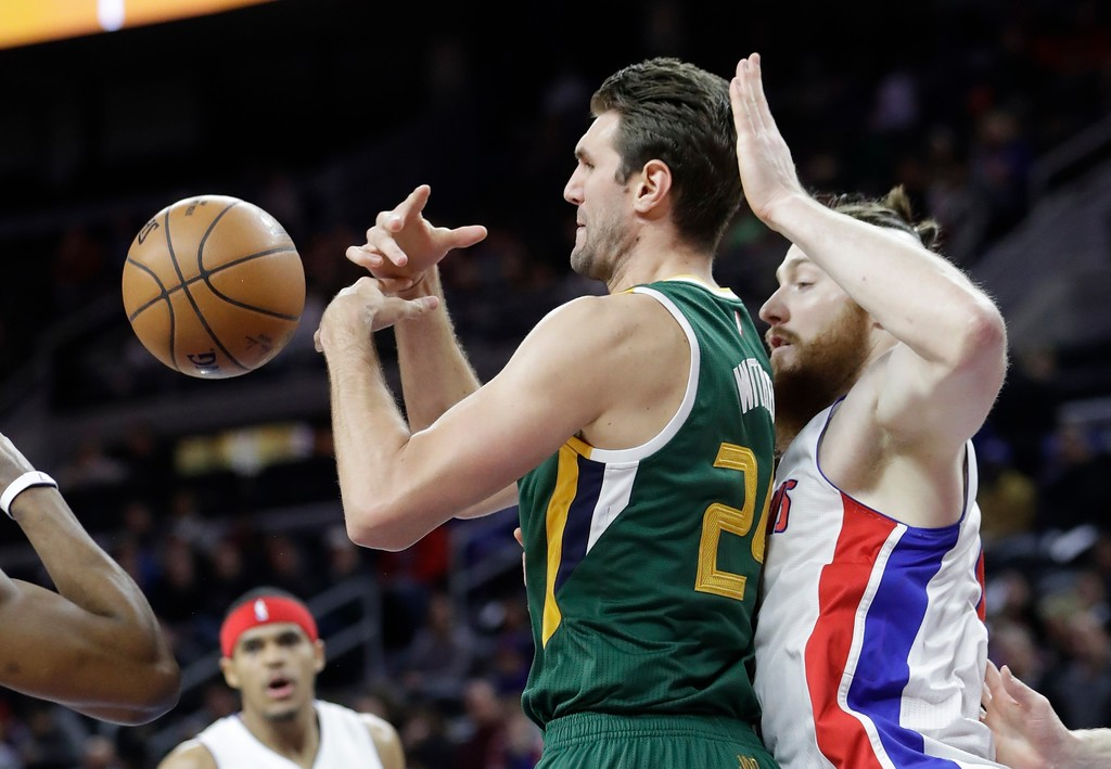 . Utah Jazz center Jeff Withey has the ball knocked out of his control during the first half of an NBA basketball game against the Detroit Pistons, Wednesday, March 15, 2017, in Auburn Hills, Mich. (AP Photo/Carlos Osorio)