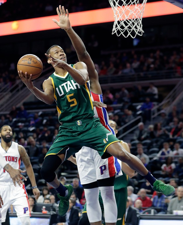 . Utah Jazz guard Rodney Hood (5) shoots during the first half of the team\'s NBA basketball game against the Detroit Pistons, Wednesday, March 15, 2017, in Auburn Hills, Mich. (AP Photo/Carlos Osorio)