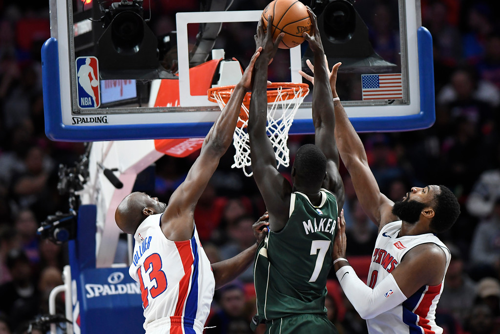 . Milwaukee Bucks center Thon Maker (7) has his shot blocked by Detroit Pistons forward Anthony Tolliver (43) and center Andre Drummond (0) in the second half of an NBA basketball game, Wednesday, Feb. 28, 2018 at Little Caesars Arena in Detroit.  The Pistons defeated the Bucks, 110-87.  (Special to The Oakland Press/Jose Juarez)
