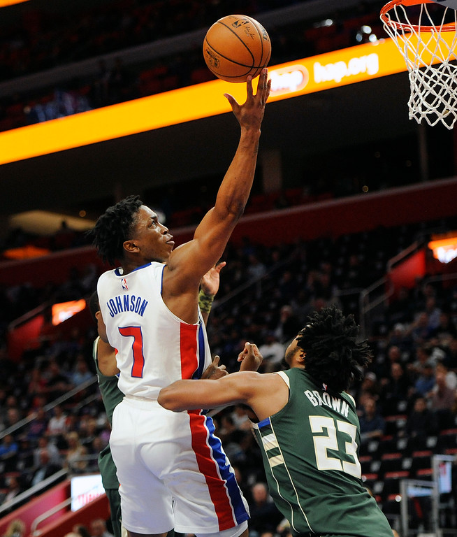 . Detroit Pistons forward Stanley Johnson (7) goes in for a layup over Milwaukee Bucks guard Sterling Brown (23) in the second half of an NBA basketball game, Wednesday, Feb. 28, 2018 at Little Caesars Arena in Detroit.  The Pistons defeated the Bucks, 110-87.  (Special to The Oakland Press/Jose Juarez)