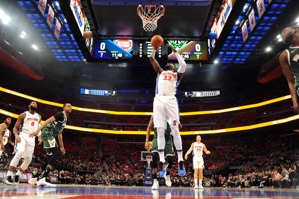 . Detroit Pistons forward James Ennis III (33) rebounds against the Milwaukee Bucks in the first quarter of an NBA basketball game, Wednesday, Feb. 28, 2018 at Little Caesars Arena in Detroit.  The Pistons defeated the Bucks, 110-87.  (Special to The Oakland Press/Jose Juarez)