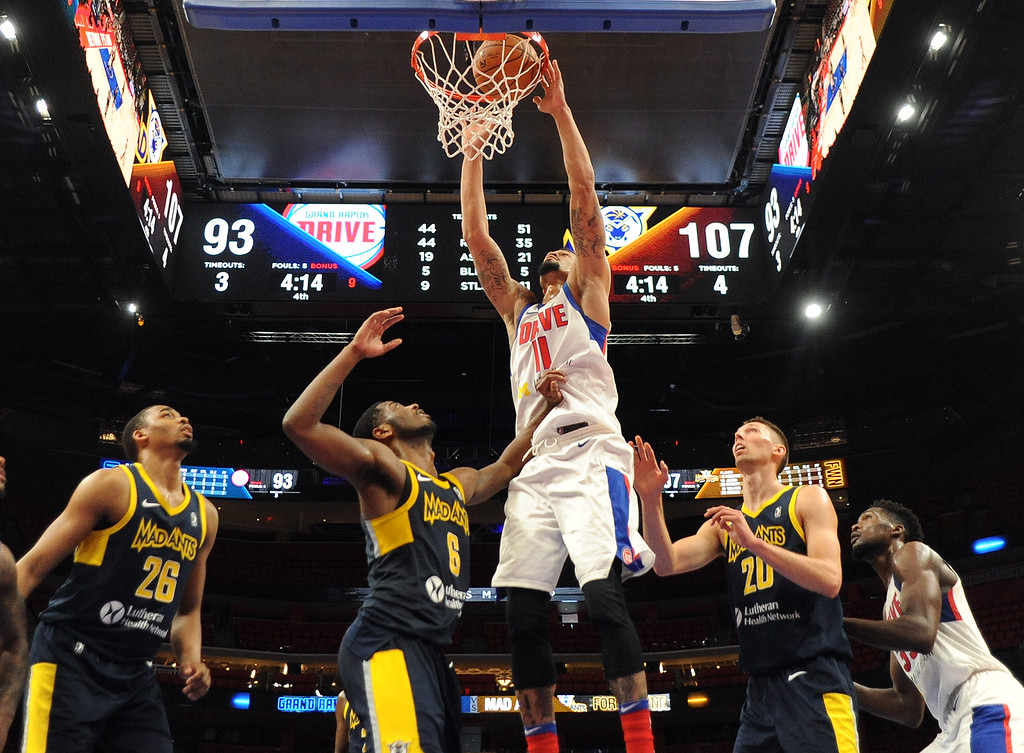 . Grand Rapids Drive guard KJ McDaniels (11) dunks against the Fort Wayne Mad Ants, the D-League affiliate for the Indiana Pacers, Wednesday, Feb. 28, 2018 in Detroit.  The Mad Ants defeated the Drive, 115-104.  (Special to The Oakland Press/Jose Juarez)