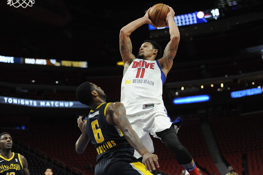 . Grand Rapids Drive guard KJ McDaniels (11) goes up over Fort Wayne Mad Ants guard Tra-Deon Hollins (6), Wednesday, Feb. 28, 2018 in Detroit.  The Mad Ants defeated the Drive, 115-104.  (Special to The Oakland Press/Jose Juarez)